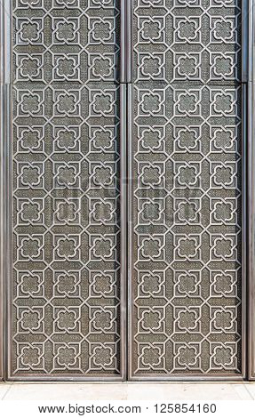 Casablanca, Morocco - March 21, 2014: The iron door in Grand Mosque of Hassan II on March 21, 2014 in Casablanca Morocco