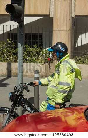 One Man Park His Motorcycle Waits For Traffic Light On The Road In Casablanca