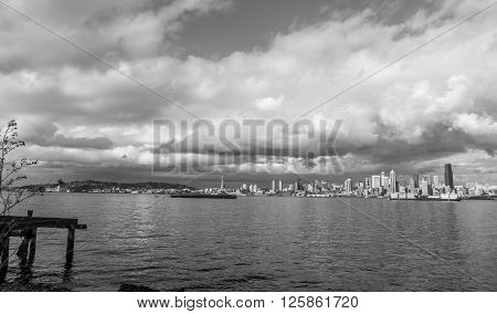 Billowing clouds hover over the Seattle skyline. Black and white image.