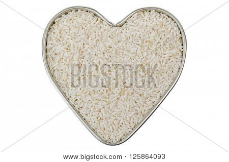 Heart shaped tin pan full of raw white Sticky rice, also called Glutinous rice grains grown in Roi-et, Northeast of Thailand, isolated on white background