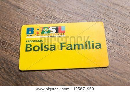 SAO PAULO, BRAZIL - CIRCA APRIL 2016: Bolsa Familia Card. Bolsa Familia is a social welfare program of the Brazilian government, part of the Fome Zero.