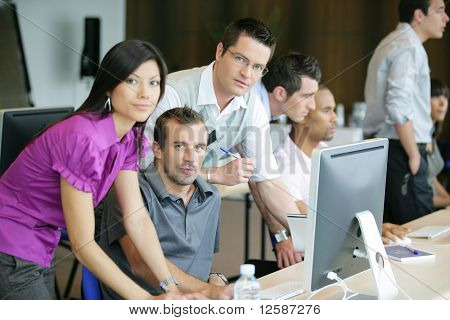 Portrait of men and a woman in the office at a computer