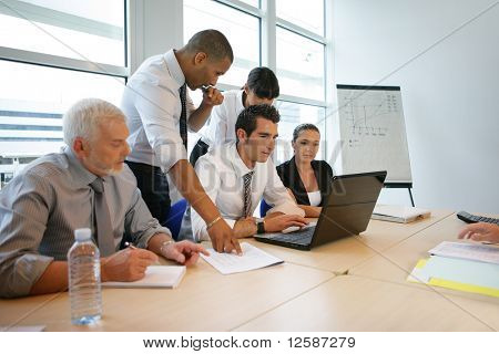 Business people in a meeting with a laptop computer
