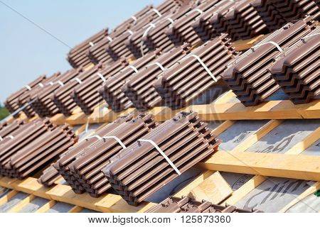 House under construction. Roofing tiles preparing to Install