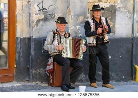 Lviv Ukraine - July 5 2014: Street folk musicians on performing in historic center (Rynok Square)