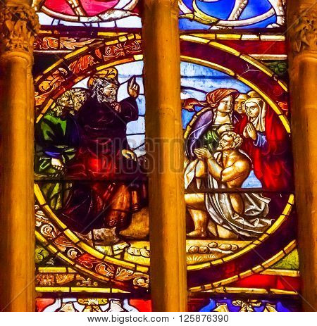 TOLEDO, SPAIN - MAY 16, 2014 Jesus Blessing Lazarus Stained Glass Cathedral Spanish Flag Toledo Spain. Cathedral started in 1226 finished 1493