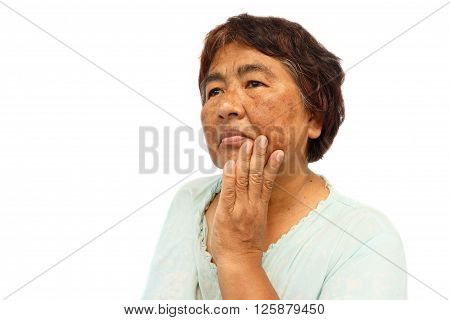 old rural woman with blemish acne mole and wrinkle on her face ( isolated background and blank area at left side ) ( anti-aging concept )