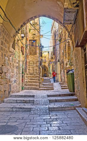 JERUSALEM ISRAEL - FEBRUARY 16 2016: The streets of the old city preserved their unique atmosphere the lazy walk here is the great pleasure on February 16 in Jerusalem.