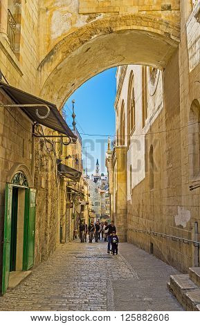 JERUSALEM ISRAEL - FEBRUARY 16 2016: The Via Dolorosa is the narrow street inside the walled town that leads from the Lions' Gate to the Church of the Holy Sepulchre and shows the way of Christ on February 16 in Jerusalem.