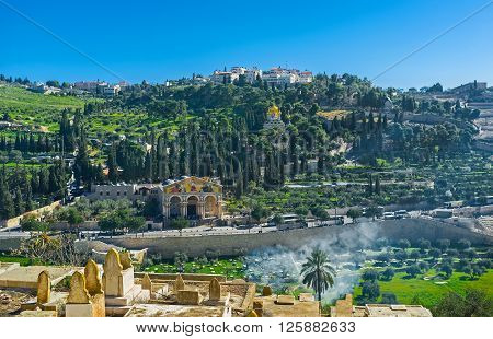 The view from the Muslim Cemetery on the of Mount of Olives with the Gethsemane Garden Churches of All Nations Mary Magdalene and Dominus Flevit Jerusalem Israel. poster