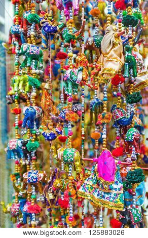 The wind chimes with colorful toys are the perfect gift Jerusalem Israel. ** Note: Visible grain at 100%, best at smaller sizes