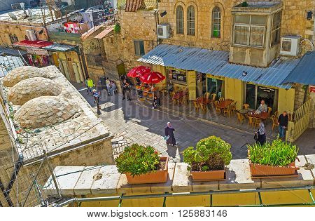 JERUSALEM ISRAEL - FEBRUARY 16 2016: The view on cozy cafes of Via Dolorosa street from the terrace of Austrian Hospice on February 16 in Jerusalem.