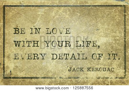 Be in love with your life - famous American writer Jack Kerouac quote printed on grunge vintage cardboard