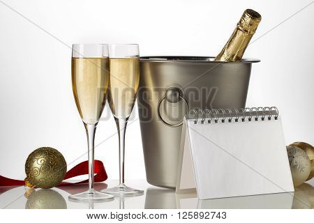 Champagne Bottle Flutes And Ice Bucket With Christmas Baubles