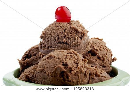chocolate ice cream with cherry isolated on a white background