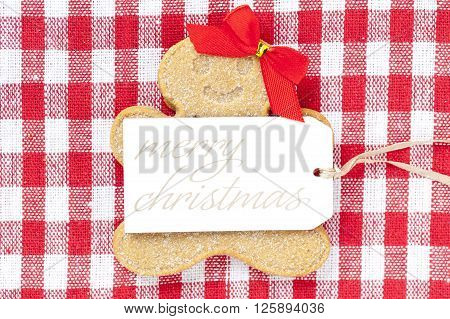 Close Up Of Gingerbread Female With Merry Christmas Tag