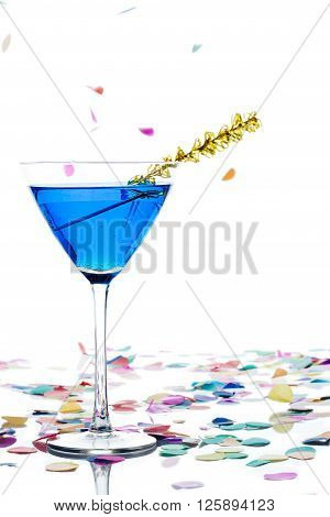 Close Up Shot Of Blue Alcohol In Martini With Streamer And Confetti