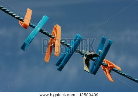 Colored clothes clips on a string