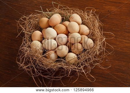 Closeup view of a basket with eggs on a wooden table