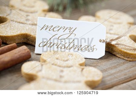 Low Depth Of Field Shot Of Gingerbread Men With A Merry Christmas Tag