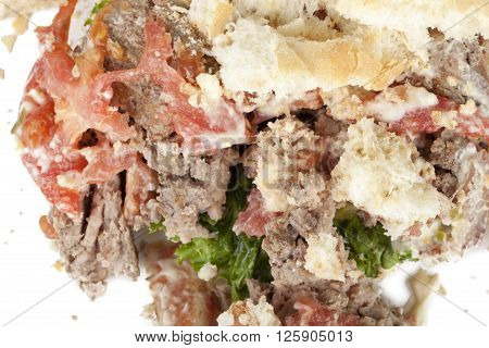 Image of mangled hamburger isolated on white background