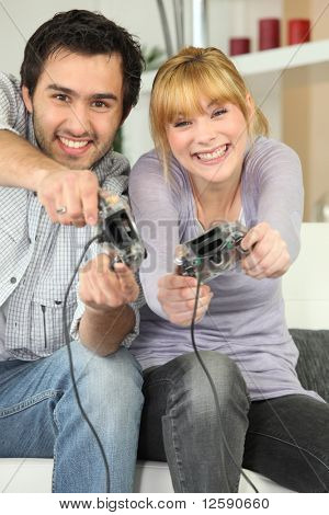 Young people having fun with joystick in the hand