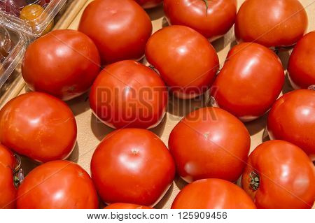 Red Tomato In Market From Market Shelves Real With Flaws And Bru