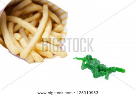 soldier shooting a bunch of fries isolated on white background
