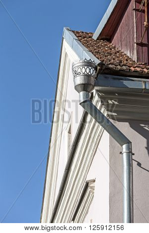 Old Downspout On Wall Of Building