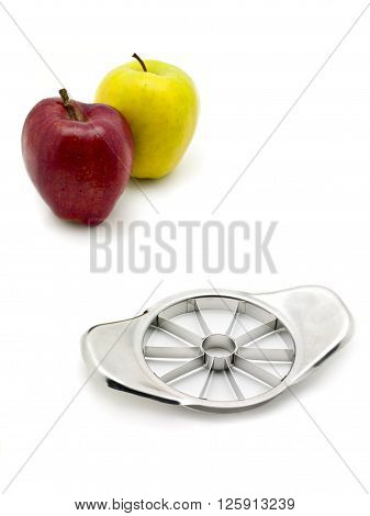 two apples and a slicer isolated on white background