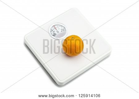 weighing scale and orange isolated on white background