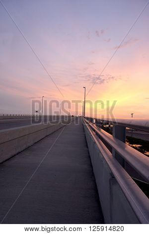 Beautiful orange sky at sunset over the bridge leading to Clearwater, Florida
