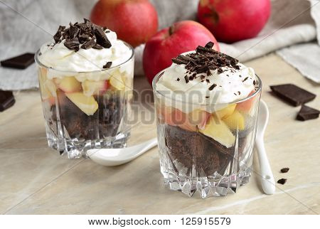 Apple Trifle with chocolate in glasses, selective focus