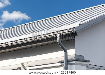 Gray Metal Roof With Gutter And Drainpipe