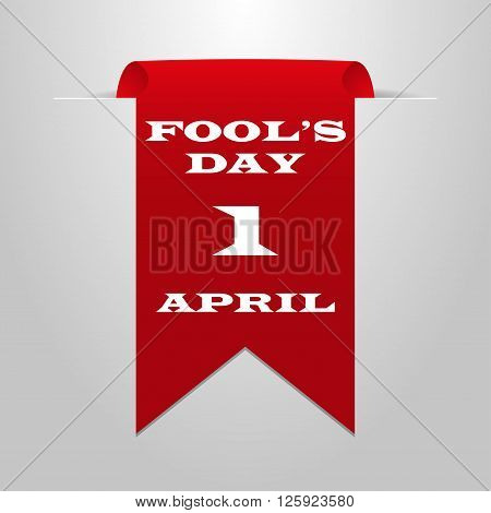 Red ribbon on a gray background. Fool's Day on 1 April