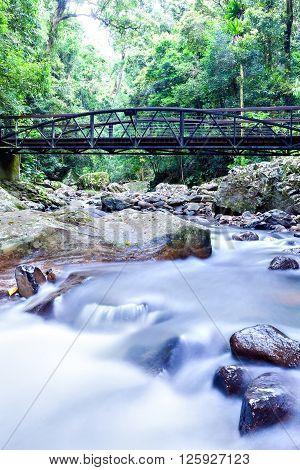 Colorful River Running Like A Smoke Through The Shiny Rocks