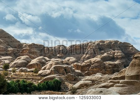 Canyon in Petra (Rose City), Jordan. The city of Petra was lost for over 1000 years. Now one of the Seven Wonders of the Word. As-Siq Petra Lost rock city of Jordan.