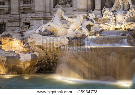 Detail of Trevi fountain in Rome, iluminated by night.