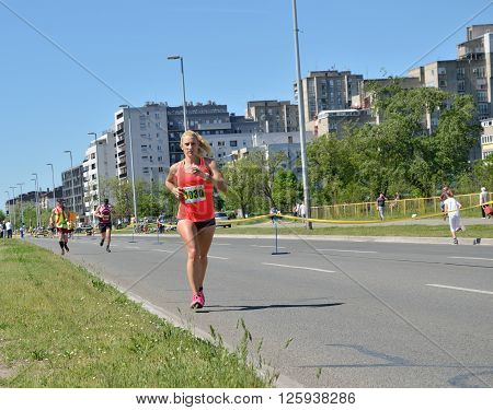 Belgrade Serbia - April 16 2016: 29th Belgrade Marathon. Rrunners during marathon race. Winners are Abel Kibet Rop with time 2:23:58 and Stella Barsosio 2:43:41 both from Kenia.