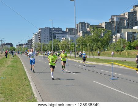 Belgrade Serbia - April 16 2016: 29th Belgrade Marathon. A group of runners during marathon race. Winners are Abel Kibet Rop with time 2:23:58 and Stella Barsosio 2:43:41 both from Kenia.