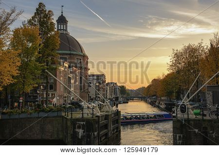 Amsterdam-Center, Netherlands, October 26, 2015, a beautiful view on the canal Singel and Koepel church  in the center of Amsterdam