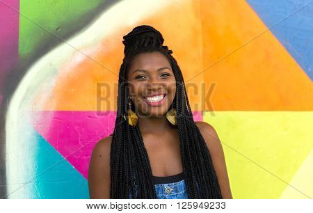 Afro girl smiling on colorful background