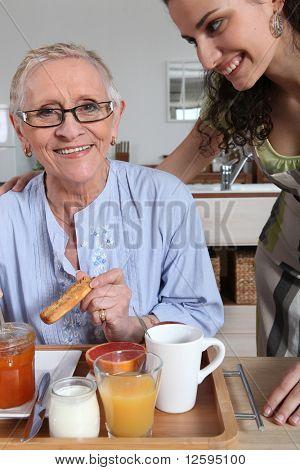 Senior woman having breakfast