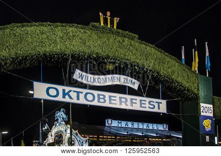 MUNICH, GERMANY - SEPTEMBER 18, 2015: Nightshot of the main entrance gate to the Oktoberfest at Theresienwiese in Munich
