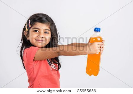 indian girl with cold drink bottle, asian girl drinking cold drink in pet bottle, girl kid and cold drink, indian cute girl with mango or orange cold drink in plastic bottle, isolated
