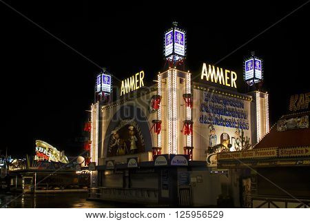 MUNICH, GERMANY - SEPTEMBER 18, 2015: Nightshot of the Ammer Gefluegelbraterei building on Theresienwiese