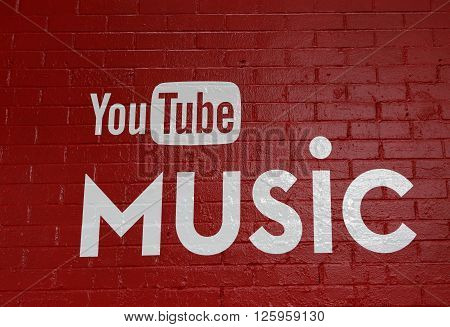 March 19, 2016, Austin, Texas. South by Southwest Annual music, film, and interactive conference and festival, SWSX. YouTube logo on red brick wall.
