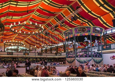 MUNICH, GERMANY - OCTOBER 02: Inside the Marstall beer tent on Theresienwiese with people celebrating Octoberfest