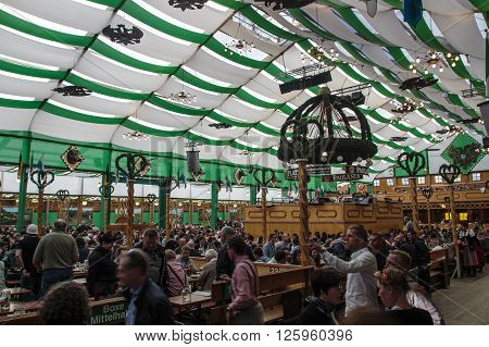 MUNICH, GERMANY - OCTOBER 02: Inside the Armbrustschuetzenzelt on Theresienwiese with people celebrating Oktoberfest