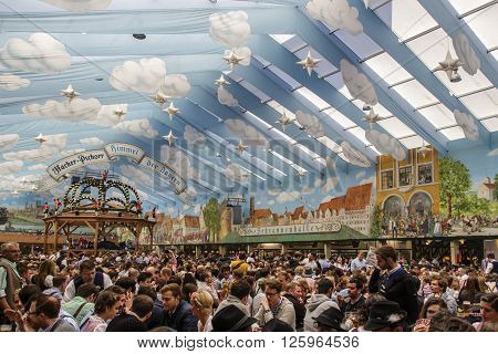 MUNICH, GERMANY - OCTOBER 02: Inside the Hacker Festzelt (Himmel der Bayern) on Theresienwiese at Oktoberfest with its lovely decoration of the roof and the surrounding walls